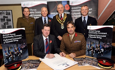 The Council's Armed Forces Champion Cllr Craig Middle signing the Armed Forces Covenant  on behalf of Rhondda Cynon Taf Council.