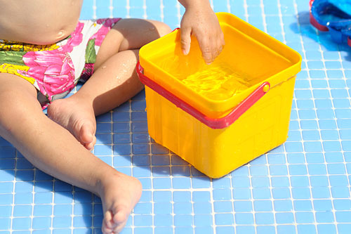 baby-playing-with-a-bucket