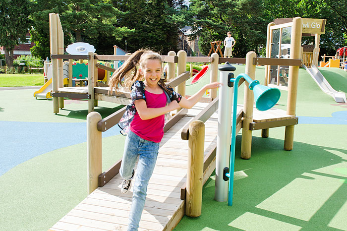 kid-running-on-play-equipment